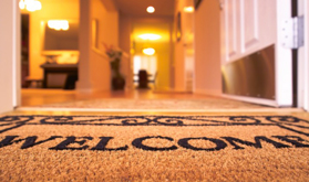 Warm home with a welcome sign.