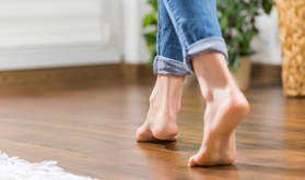 Woman walking across floor with underfloor heating