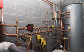 Commercial plumbing pipes and large water tank
